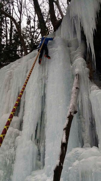 Same TR route with climber on rope. Slight ice bulge near top of first vertical section.