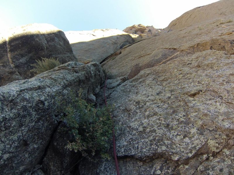 BETA! Do not climb the huge dihedral! Route finding is tricky. There should be a horn slung with old webbing, that is where you should build a belay for the traverse. allow plenty of time for the approach, as it is at the opposite side of the wall from the gully.