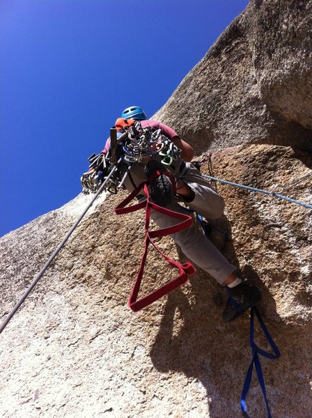 Bryan on the overhang that starts pitch 3. The tag line marks vertical.
