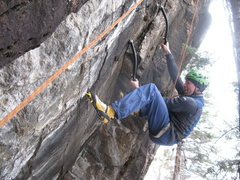 Rock Climbing Photo: Ryan Bogus laying back the start to Spider Nutz.