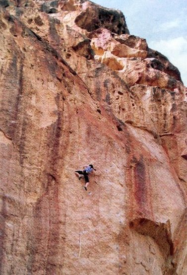 Kathy Yaniro on Iron Lung (5.11+), Leslie Gulch<br> <br> Photo by Rudy Hofmeister