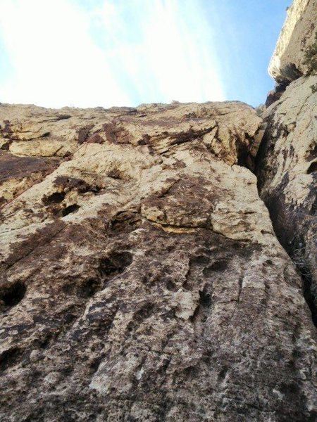 Looking up at the great finger crack at the start of Pitch 2.  You can vaguely see the rope to the left of the frame.