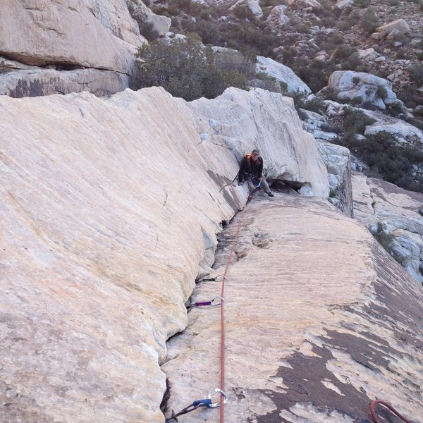 Looking down the layback pitch of Dodgeball.  My good friend and climbing partner Dave Gifford belaying.