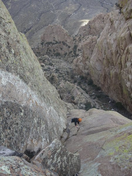 Victor approaching the top of the second pitch and the cruxy finger crack section