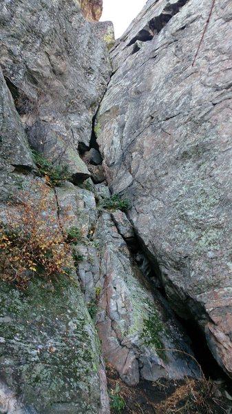 Short sweet crack.  Boulder ramp at bottom of crack takes up lower 2/3 of photo.