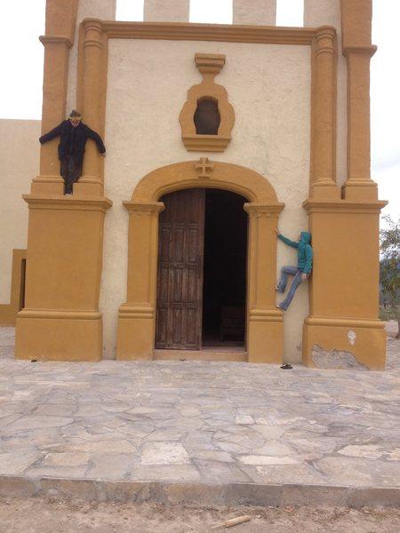 Staci and Jack climbing the church.