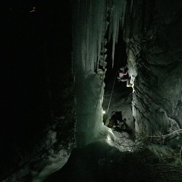 With the Moffat Column in the foreground, Angela Tomczik takes a burn of the Moffat mixed line by headlamp.