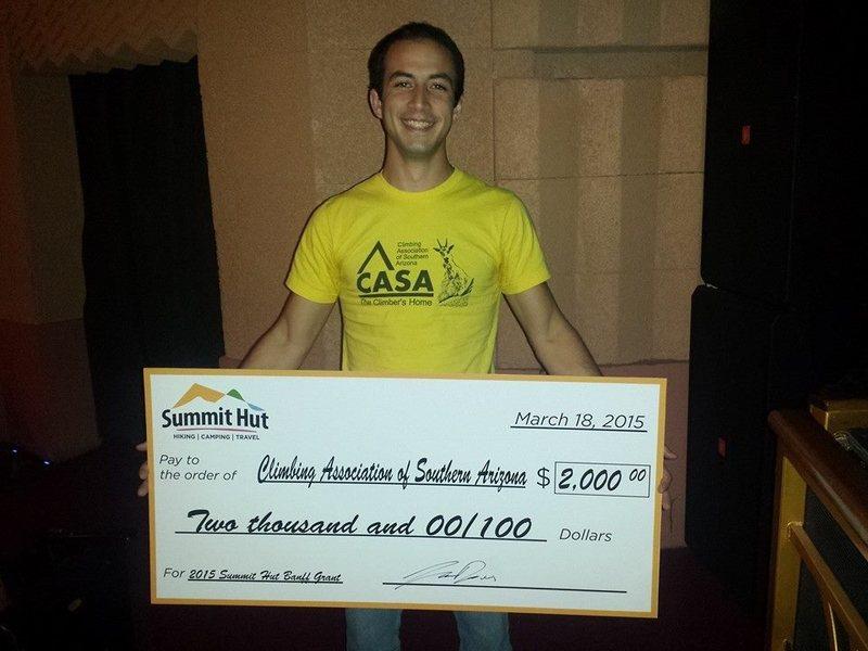 Alex Brummer, CASA grant writer, receives one of Summit Hut's $2,000 Banff Grants -- March 18, 2015 at the Banff Film Festival.