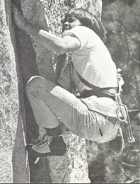 Tobin Sorenson cranking the crux of Insomnia, 1973...wearing a swami belt (no harness) a fresh pair of EBs (Ellis Brigham...made in England) and check out that rack!