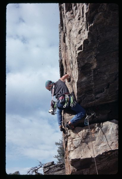 Going for the committing moves after turning the overhang.  Just one of the 465 routes done...