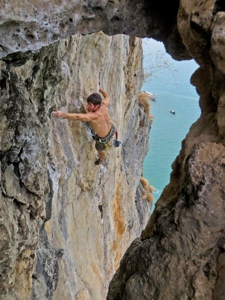 About to pull into the high crux. Just blew the flash on The King and I, 7a at Thaiwand Wall on West Railay Beach in Krabi, Thailand. Photo by Kira Krick.