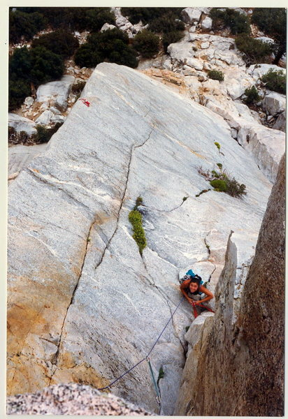 """Thi-Ly Hayes climbing up into the big recess that leads to the True Horn. You can see almost the entire """"The Edge"""" with a red sling at the infamous beay, and also visible is """"The Last Judgement"""", which takes the crack with that bush."""