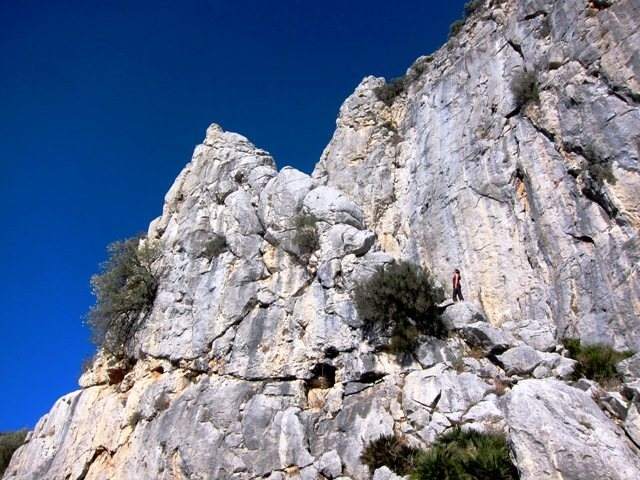 Upper Crag at the Arab Steps.  Climber at base of El pilarito.
