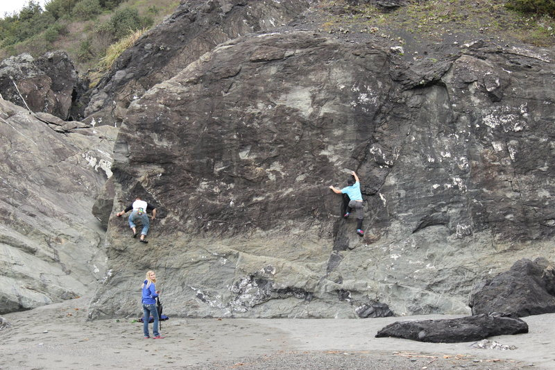 Mikey and Drew tag-teaming a boulder on the north beach.
