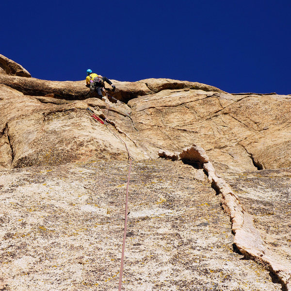 The amazing 2nd pitch on Cream of Wheat - the 5.8 roof/lip crux move is relatively easy for the grade, the runouts and pro are a bit more challenging