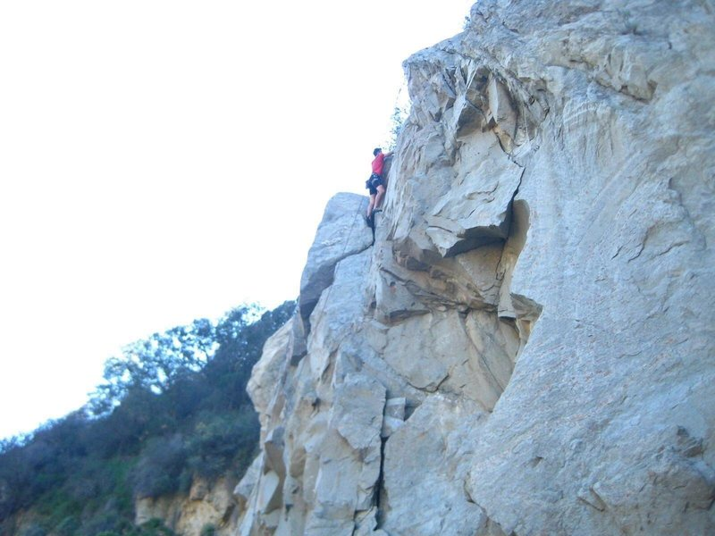 This climber went too far left and is making his way back right to the anchors for Original Route.