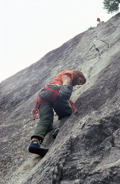 Chuck Wilfley following the second pitch with Paul Petersen at the belay. 1980.