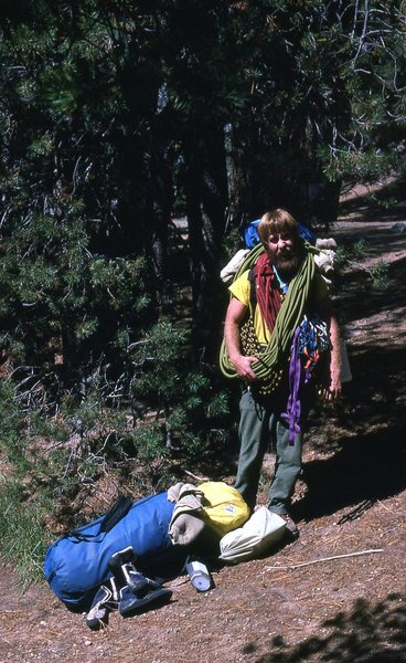 Rock Climbing Photo: Chuck Wilfley Schlepping gear to the base. 1980.