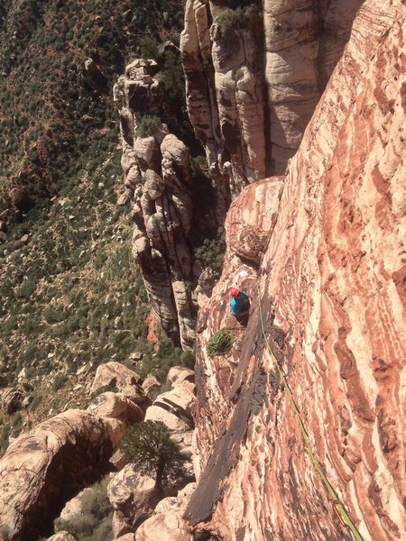Looking back at the sweet ledge from partway up the final pitch on Olive Oil