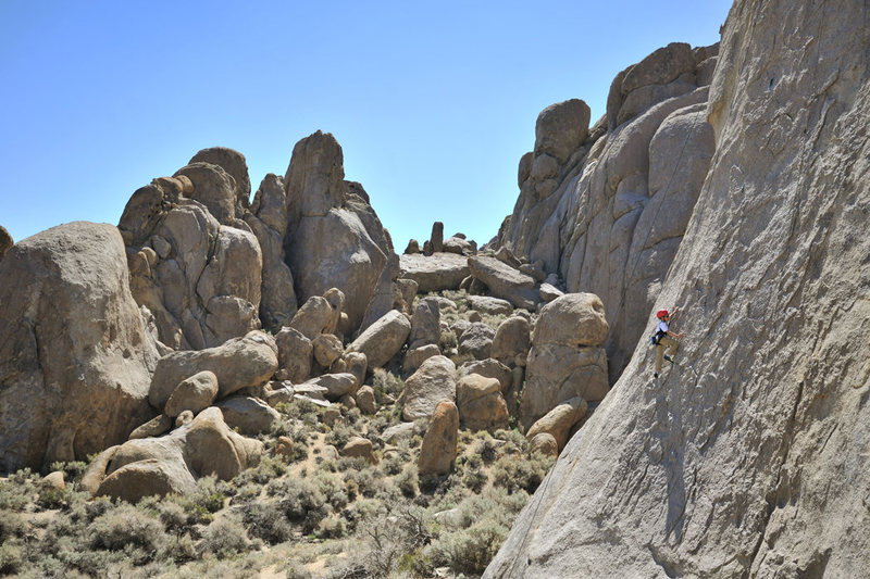 Eight-year-old Bryson Fienup climbs Rotten Bananas, on the Tall Wall in the Alabama Hills.