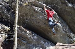 Rock Climbing Photo: Hopping up to a knob at the lip on the FA of Tripl...