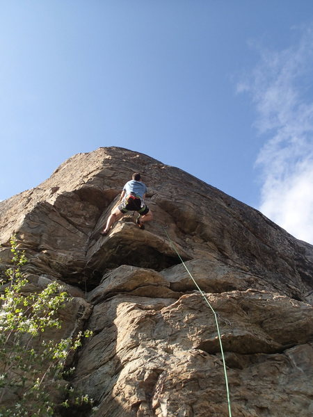 "Climber on ""Route of All Evil"""