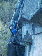 Rock Climbing Photo: Clipping the roof bolt. Pitch 1