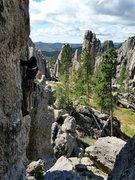 Rock Climbing Photo: John Lang works the crux (crack) of Doody Direct