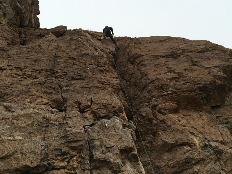 Michael Briseno at the anchors, bolt line left of rope.