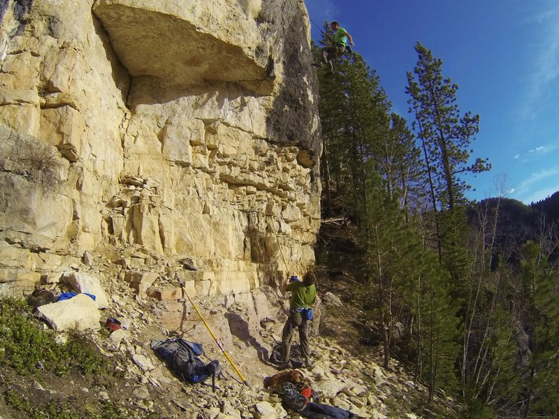 Carl takes the ride of Fishin' for a Tuesday, 5.11c<br> <br> Fishbowl Wall. Blue Sky.<br> Spearfish Canyon.
