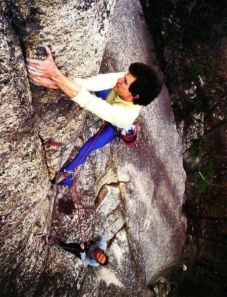 Neil Cannon belayed by Alison Osius on The Prow (5.11d), Cathedral Ledge<br> <br> Photo by S. Peter Lewis