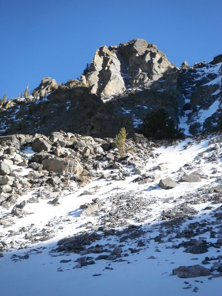 View of the East Ridge of Hallett Peak from Emerald Lake. Astro Turf climbs the large, outward-facing dihedral in the center of the feature (in shade, with intermittent snow patches).