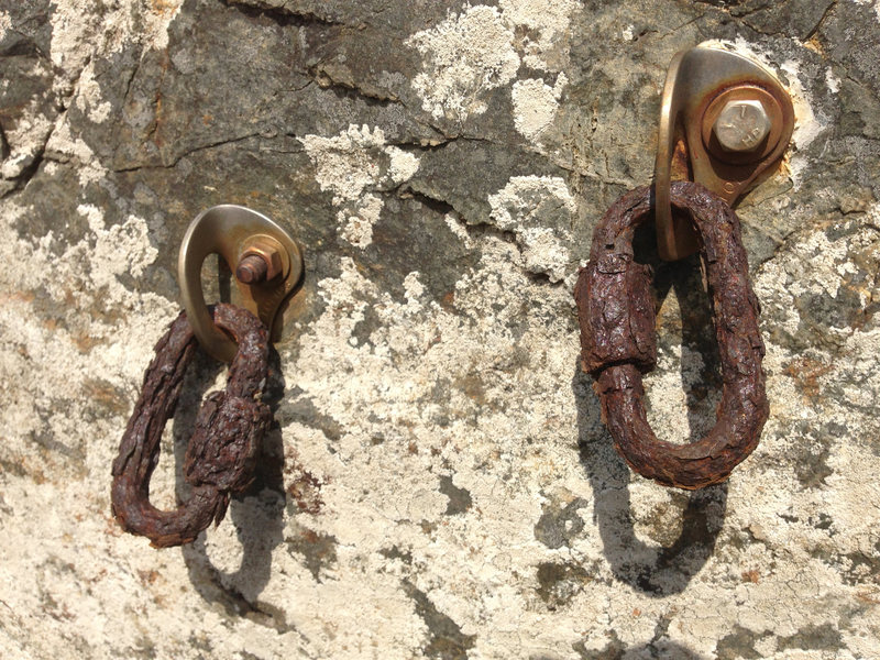 Wow. <br> Anchor bolts for the 5.10b TR. Might as well skip the bolts and use your tree anchor for the belay. <br> <br> I also noticed these are the same bolts, hangers, and rusted quick links as on the wall 100' NE of Dizzy Dial. Does anyone know who did these FAs?