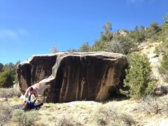 This is the first boulder that we use as a marker to fined the wave boulder. There are 4 routs on it, one is super hard starting in the hole go right to crimp. On the left is a fun mantle that goes at about v4, hold my tree v3 is on the right behind the pine tree.
