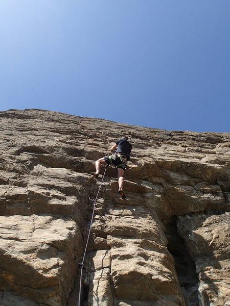 Climber at the crux of Metamorphosis