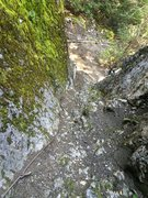 Gully with rope to get up to the base of the route.