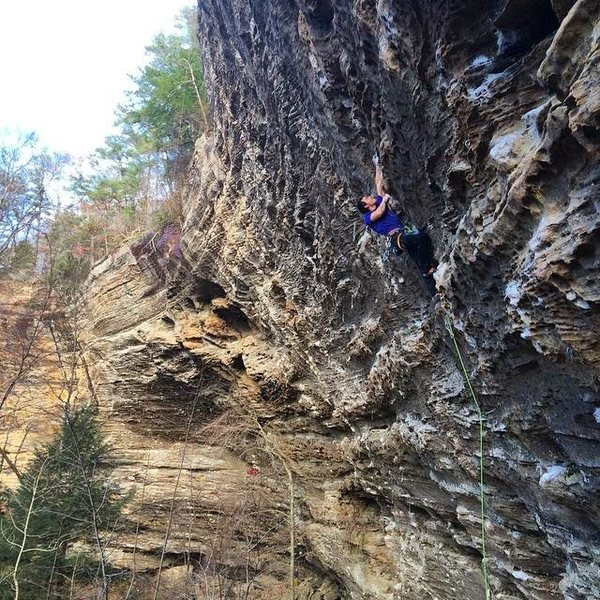 Buddy Alex working a 5.13 at the Lode