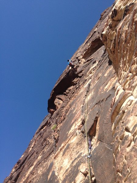 Me leading on the start of pitch 4. Started the traverse well below the roof.  Nice holds.