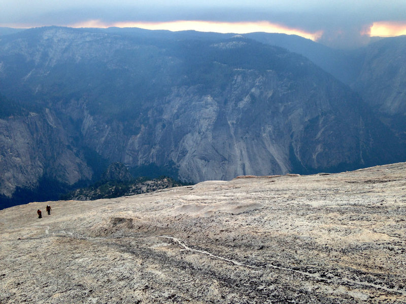 Coming up the slabs after the technical climbing was done. The smoke from the El Portal fire that started while we were up there is visible in the background.