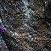 Kailee Jamieson checking her feet during the crux of The Roach