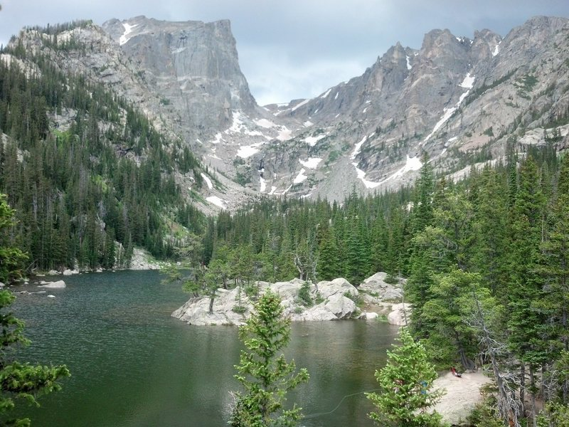 This is Dream Lake in RMNP. I'm wondering what the amazing granite face on the left is and if there happen to be any established routes on it. Any beta on this??<br> <br> Rock on!