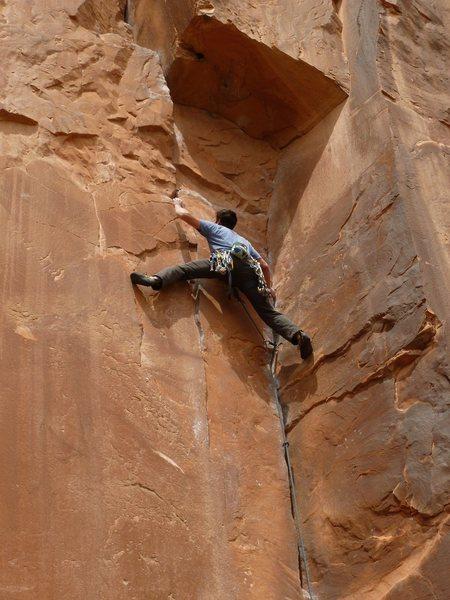 Matt below the roof, entering the crux of the climb