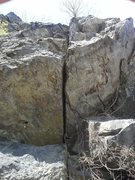 Rock Climbing Photo: The crux roof move near the base of the crack.