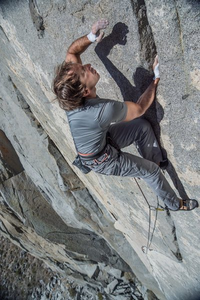 Glory handjamming to the anchors<br> <br> Photo:Jeff Fox<br> Climber: Julien Lecorps
