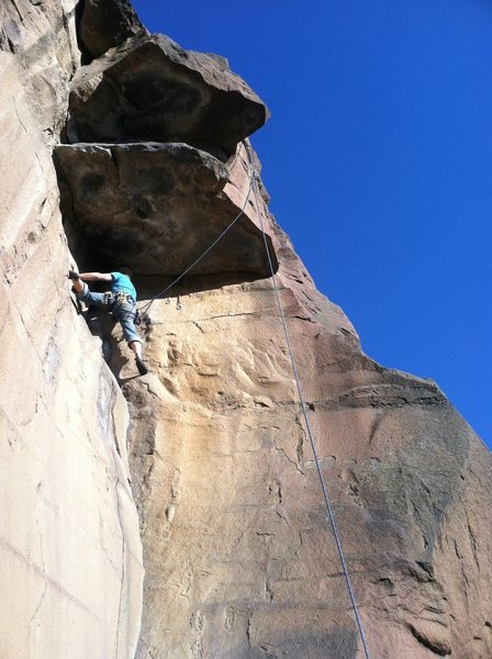 Brian getting ready to cross the nearly footless traverse along the right side of the shadowed roof.