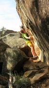 Rock Climbing Photo: Reaching the left hand, flat shelf on Paperboy.