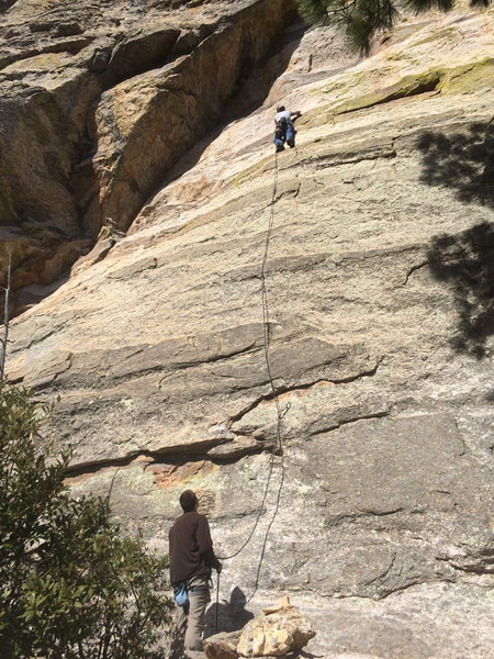 Cory P working the crux of Jack the Slipper on lead.