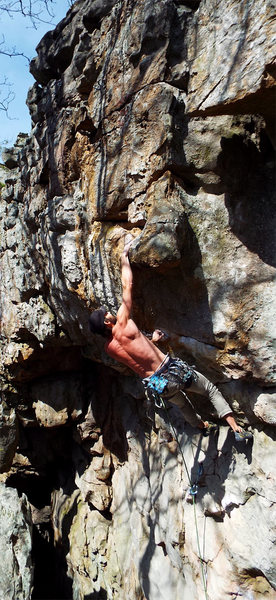 Heave Ho 5.11a Deadpoint move at crux.