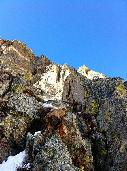 Rock Climbing Photo: The loose crux of P1 (foreground) with the crux pi...