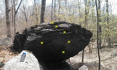 First problem in description starts under the roof on the left side of the boulder.